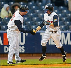 Mud Hens manager Phil Nevin, left, congratulates Bryan Holaday after he hit a home run.