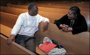 The Rev. Nathaniel Adams Jr. of Euclid talks with the Rev. Christine Thompson of Cleveland between sessions during the conference.