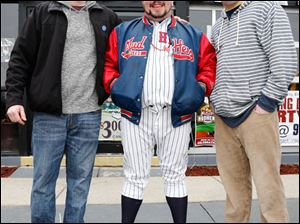 Left to right Chris Smith, Aaron Swartz, and Bill Cole enjoy Toledo Mud Hens opening day festivities Ye Olde Durty Bird.
