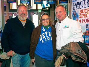 Left to right Ron Maher, Sandi Rabie, and Patrick Andrews enjoy Toledo Mud Hens opening day festivities at Packos at the Park.