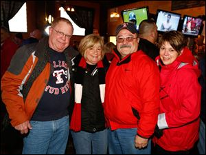 Left to right John and Shelley Sutherland along with Tim and Dee Janney enjoy Toledo Mud Hens opening day festivities at Ye Olde Cock N' Bull.