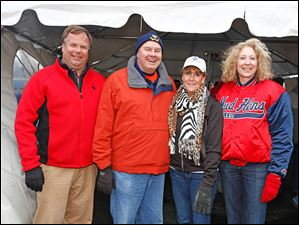 Left to right Neal Mahoney, Brad Crown, Debbie Petersheim, and Sandra Hylant during the Midland Title Tailgate Party.