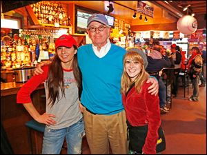 Rikki Dukes, Ken Kuhlman, and Trilby Fox enjoy Toledo Mud Hens opening day festivities at the Bronze Boar.