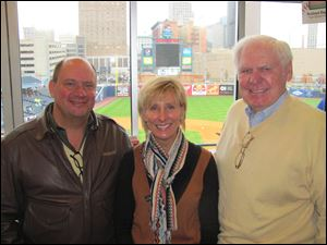 Dave White, Mike Cicak, and Hilary White in the White Family Dealership, OI, and Maumee Bay Brewing Company suite.