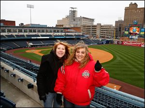 Tammy Degner and her sister Annie Stevens enjoy Toledo Mud Hens opening day festivities.