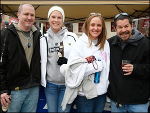 Left to right Sean Mitchell, Sandra Mitchell, erin Whaley, and Dave Weis enjoy Toledo Mud Hens opening day festivities.