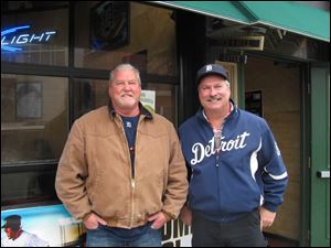 Tom Marckel, wearing a Detroit Tigers shirt and Glenn Taptich, in tan jacket to keep warm, did a pub crawl in the morning then had their own tailgate party in the afternoon