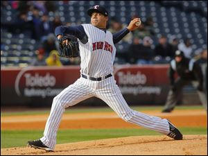 Toledo Mud Hens pitcher Jose Alvarez fires in a pitch in the second inning.
