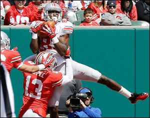 OSU's Michael Thomas makes a catch against Eli Apple. Thomas finished with seven catches for 79 yards for the Grey squad.