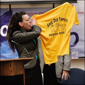 A speaker at a town-hall meeting at  the University of Toledo last year encourages the audience to support immigration reform.