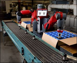In an undated handout photo, the Baxter robot from Rethink Robotics. Newer, gentler factory robots no longer have to be fenced in to protect workers from accidents.