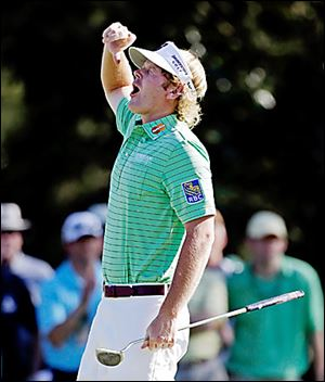Brandt Snedeker reacts after making a birdie putt on the 15th hole. He is tied for the lead.
