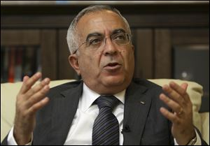Palestinian officials say Prime Minister Salaam Fayyad has officially submitted his resignation, and is waiting for a reply from President Mahmoud Abbas.