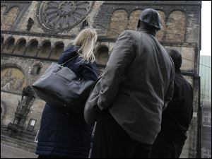 Mayor Mike Bell and Christa Luttman, a Toledoan with ties to Germany, look up at Bremen's St. Peter Cathedral in the market place of Bremen, Germany.