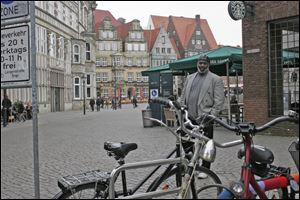 Mayor Mike Bell pauses in the marketplace in Bremen, Germany, on Sunday. Toledo officials are set to talk about the Glass City at Delmenhorst City Hall today.