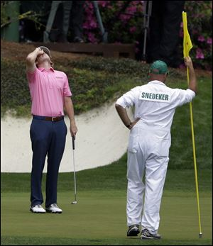 Brandt Snedeker reacts after missing a putt on the 12th green during the fourth round of the Masters.