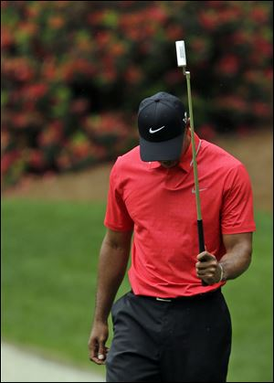 Tiger Woods holds his putter after missing a putt on the 13th hole during the fourth round of the Masters on Sunday. Woods shot 2-under 70 for the third time in four rounds, not enough to win his fifth green jacket. He finished at 5-under 283, three strokes off the lead as he went to the clubhouse.