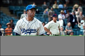 This film image released by Warner Bros. Pictures shows Chadwick Boseman as Jackie Robinson in a scene from '42.'