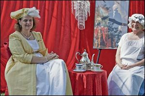 Rebecca Roper, left, and Judy French Lowell re-enact a tea of 19th century Frenchtown at the River Raisin National Battlefield Park in Monroe. A period tea will be held at the park on Saturday.