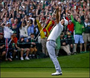 Adam Scott of Australia celebrates after making a birdie putt on the second playoff hole to win the Masters.