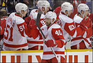 The Red Wings' Henrik Zetterberg (40) is congratulated by Valtteri Filppula (51) after scoring against Nashville in the second period on Sunday.
