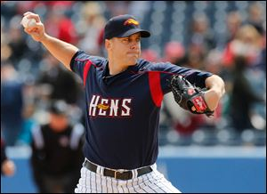 Mud Hens starting pitcher Shawn Hill fires a pitch during the first inning. The 31-year-old right-hander held Louisville in check for seven innings, limiting the Bats to five hits and two runs but taking a hard-luck loss.