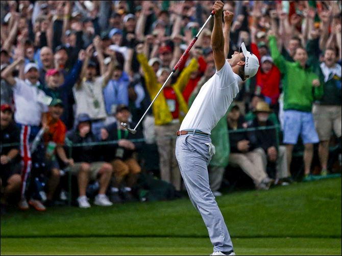 Masters Golf Scott 4-15 Adam Scott of Australia celebrates after making a birdie putt on the second playoff hole to win the Masters.