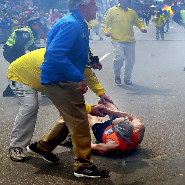 APTOPIX-Boston-Marathon-Explosions-runner-down