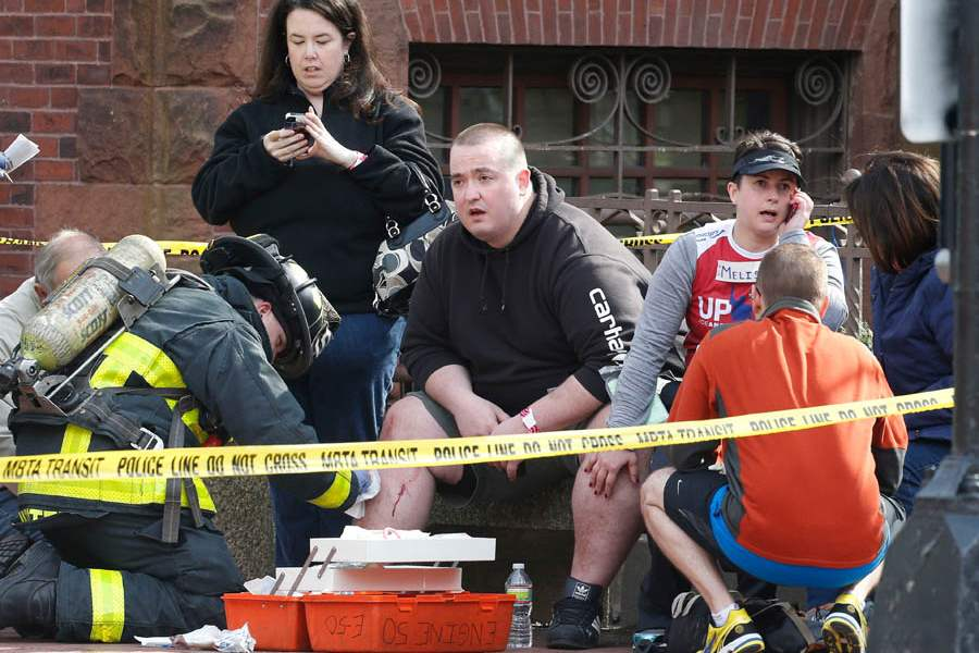 Boston-Marathon-Explosions-tending-to-injured-man