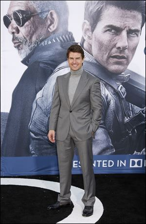 "Tom Cruise arrives at the LA premiere of ""Oblivion"" at the TCL Chinese Theater on April 10."