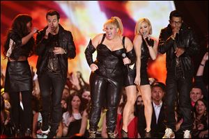 Host Rebel Wilson and the cast of