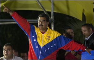 Venezuela's newly elected President Nicolas Maduro celebrates his victory after the official results of the presidential elections were announced, at the Miraflores Palace in Caracas, Venezuela, late Sunday.
