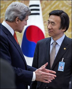 John Kerry and South Korea's Foreign Minister Yun Byung-se share a few words during the U.S. secretary of state's first-ever visit to Seoul.