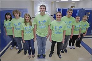 From left, Alyssa Webster, Matt Wensink, Alexa Wegman, Trevor Walsh, Byron Swartz, Grant Blackburn, Autumn Walker, and Gabrielle Matlack are among those staging the race/walk on May 25.