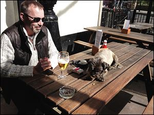 Simon Cross, with his dog, Poppy, at a London pub, said Margaret Thatcher was 'no better or worse than any other prime minister.'