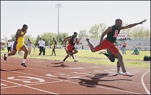 Rogers senior Michael Lipkins stretches out to win the 100-meter dash at the City League meet last year. He also won the 200.
