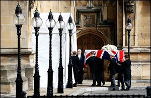 The flag-draped coffin holding the body of Margaret Thatcher, former British prime minister,  arrives at the Houses of Parliament in London on Tuesday.