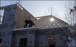 A worker helps frame a new home under construction in Matthews, N.C., in March.