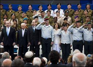 Israeli Prime Minister Benjamin Netanyahu, left, Israeli President Shimon Peres, second left, and Israeli military's chief of staff Lt. Gen. Benny Gantz, fourth left, mark Israel's Independence Day celebration at the President's residence in Jerusalem, Israel, today.