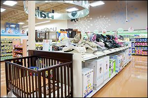 Kroger's new store in Holland, to be built in 2014, will have a wider array of products, including cribs and car seats in its Baby World section.