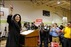 Anita Lopez holds up a cell phone and urges supporters to text her campaign to get on her list for updates. She spoke at a rally at the Aurora Gonzalez Community Center, where she officially announced her run for mayor.
