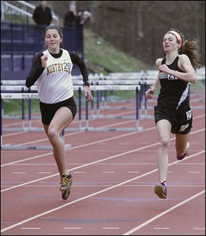 Northview's Janelle Noe, left, and Perrysburg's Courtney Clody race in the 1600-meter run Saturday at the Unitversity of Toledo high school invitational. Noe placed third in the 300-meter hurdles last year at the Division I state