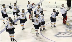Members of the Walleye say goodbye to fans after being defeated in overtime by Cincinnati in Game 6 of an ECHL quarterfinal series.