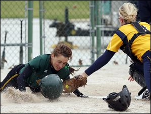 Oregon Clay's Lindsay Schiavone gets by Notre Dame catcher Cory Brickman in the fourth inning.