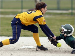 Oregon Clay's Courtney Quinlan (5) steals second base against Notre Dame's Amanda Del Monte (13) during the fifth inning.
