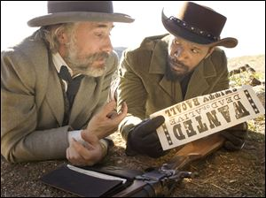 Christoph Waltz as Schultz, left, and Jamie Foxx as Django in the film, 'Django Unchained,' directed by Quentin Tarantino.