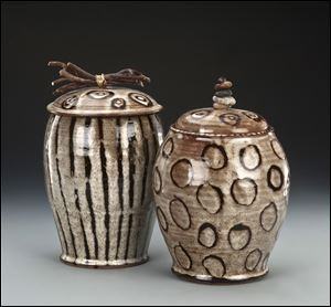 Two jars are part of potter Julie A. Beutler's Sticks and Stones series that feature unusual handles.