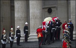 The Union flag draped coffin, holding the body of British former Prime Minister Margaret Thatcher, is carried up the stairs to St Paul's Cathedral. It is the second time in history the Queen will be attending the funeral of a prime minister, after Winston Churchill.