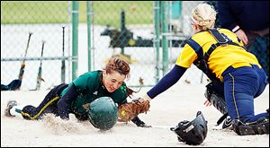 Clay's Lindsay Schiavone scores against Notre Dame catcher Cory Brickman in the fourth inning.