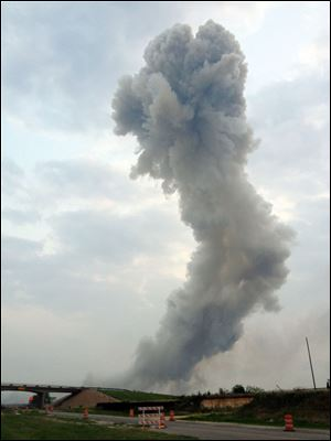 In this Wednesday photo provided by Joe Berti, a plume of smoke rises from a fertilizer plant fire near Waco, Texas.